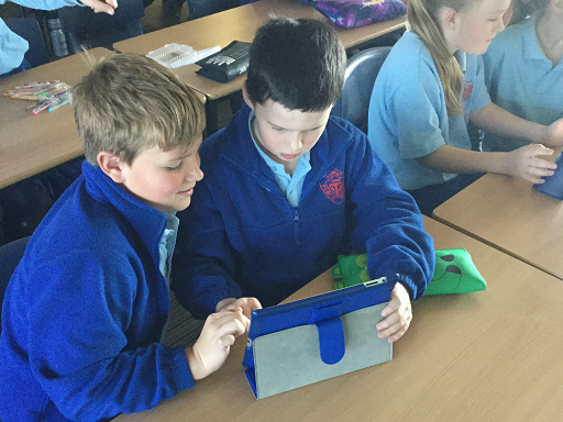 Students working on an iPad