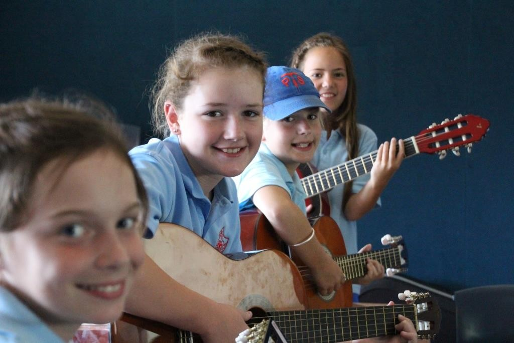 Girls playing guitar